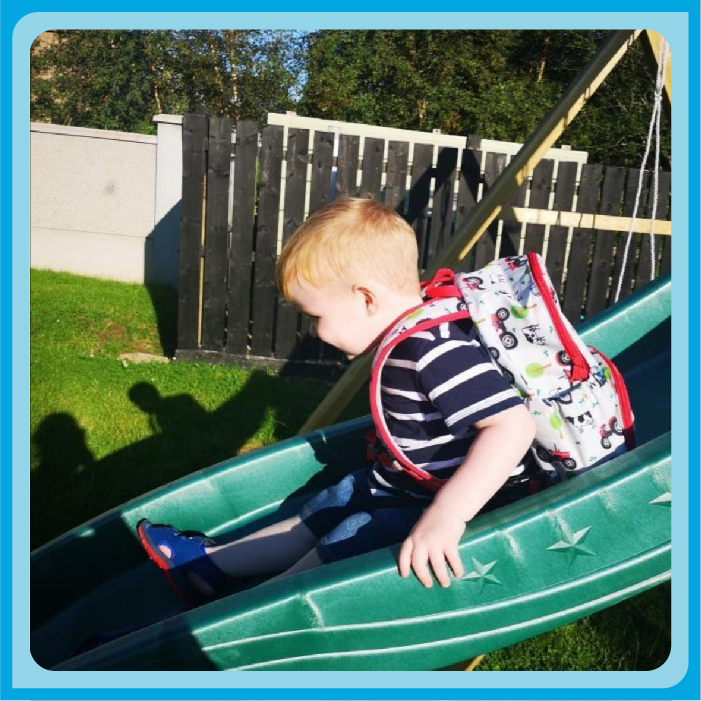 Padraig playing on the slide